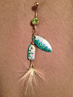 Oh my God I want this so bad! Green and Blue Fishing Lure Bellybutton Ring on Etsy, $14.00