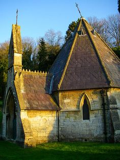 The old historic Church and cemetary of St Mary the Virgin in the neighborhood of Smallcombe on the outskirts of Bath, Somerset England. The time was a few minutes before sunset which highlighted the old stone construction.