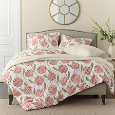 Charlotte Luxury Sateen Flannel Duvet Cover & Sham - 6 oz. cotton German sateen flannel. This invitingly soft sateen weave resists pilling, wash after wash. Bursting with long-stemmed hydrangeas, our floral flannel duvet cover brightens the bedroom in upbeat shades of coral, geranium & cream. A soft-to-the-touch complement to your flannel sheets, Machine wash. Made in Germany. | The Company Store (2.11.14)