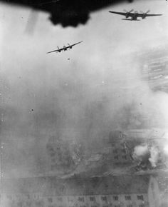The precision bombing raid by De Havilland Mosquito FB Mark VIs of No. 140 Wing, No. 2 Group, on the Gestapo Headquarters of Jutland, Denmark, at the University of Aarhus. Two Mosquitos drop their 500-lb delayed-action bombs over the already damaged halls of residence: photographed by a Mosquito of the RAF Film Production Unit, using a rear-facing mirror camera.