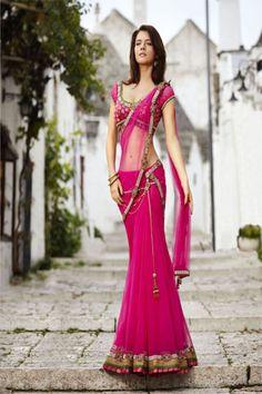 Lve the color and the saree....elegant fuschia brocade blouse with drape saree