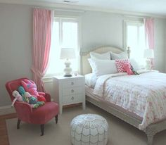 Love this room and the bed between the windows, with the curtains pushed to either side.