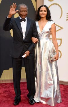 #oscarfashion Sidney Poitier and daughter Sydney Tamiia Poitier arrive at the 86th Annual Academy Awards at the Dolby Theatre in Hollywood on March 2, 2014. (Jordan Strauss/Invision/AP)