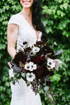 Play up your event's moody color palette with a deep burgundy dahlia arrangement—believe us, no one will see florals this dark coming (pair them with bright white anemones to enhance their depth! Max Gill Design created this spray. Poppy Wedding Bouquets, Wedding Flower Guide, Fall Wedding Flowers, Purple Wedding, Floral Wedding, Dream Wedding, Dock Wedding, Maroon Wedding, Gift Wedding