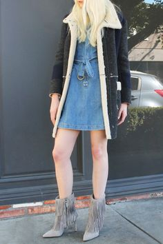 Denim Dress For Winter - Styling Tip: For added warmth, pair a thin ribbed turtleneck under this denim dress (and wear tights if it's freezing!). Finish the outfit with a cozy shearling coat and '70s-inspired fringe ankle booties.