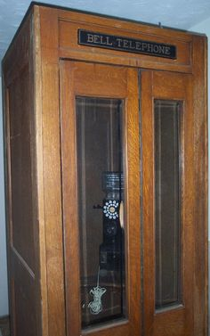 An old Bell Telephone pay phone booth. When the door was closed a light and fan came on.