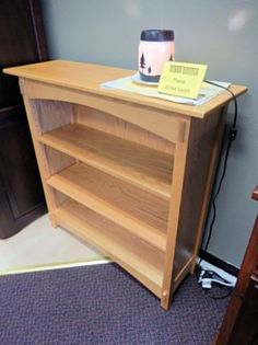 "Amish built bookcase crafted from Oak with a golden finish.  This piece features two adjustable shelves, giving you a beautiful place to store your reading treasures!  Dimensions:  38"" W x 12 1/2"" D x 36 1/4"" H  (One currently available)"