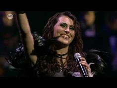 Mother Earth (Overture) & Ice Queen - Sharon den Adel (live).  Great song, great vocals, great smile.  Sharon is backed by an orchestra instead of her band Within Temptation.  Wonderful touch - very Trans Siberian Orchestra like with shades of Pink Floyd.  Rock 'n' Roll!!!