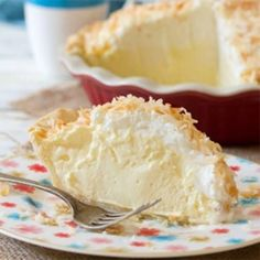 Ingredients: For the Coconut Crust: 1 1/4 cup all-purpose flour 125g COLD unsalted butter (1/2 cup) 1/3 cup shredded sweetened coconut 1/2 tsp. salt 3-5 Tb. ice cold coconut rum-Malibu For the Coco…