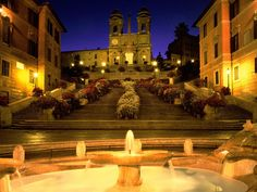 Spanish Steps in Rome, Italy.  One of my favorite spots in Rome.  This area is usually filled with people hanging out on the steps ... and sometimes bathing (actually bathing) in that fountain.  Italians know the art of la dolce vita.  I hope to be like that when I grow up.   (Not about bathing in fountains, though.)