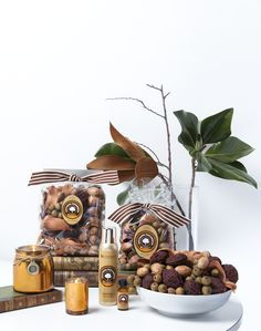 Southern Persimmon Fragrance by Aromatique- The Scent of Orchard Fruits Entwined with Tangerine and Musk. Seen Here: Decorative Fragrance, Studio Copper Jar, Votive Candle, Aerosol Room Spray, and Refresher Oil.