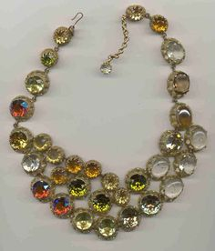 CIS asymmetric crackle glass collar with splendid colors of hyacinth AB, citrine, topaz, clear and one glass hematite-shaded stone.  Changes color depending on what you are wearing.