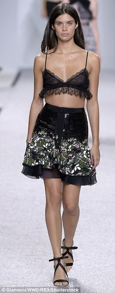 Brazilian beauty: Sara was also a sight to behold on the catwalk, showing her slender curves off in a a seriously seductive lace-fringed bra and a high-waisted mini skirt