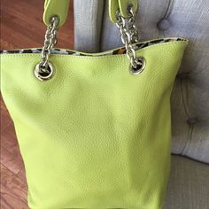 """LIME GREEN SMALL LEATHER TOTE (like new) Made in Italy of genuine leather. Looks brand new! Silver hardware with Cheetah print on inside lining. Mini Tote measures: 12""""T X 10"""" W X 3.25""""D. Strap drop 5"""" Maurizio Taiuti Bags Totes"""