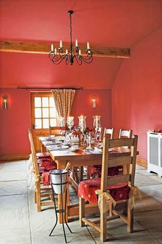 A soaring, oddly shaped ceiling feels cozy when drenched in a uniform knockout red. | Rave Red, @Sherwin-Williams
