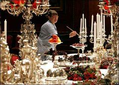 Here is a picture of one of my servants at Windsor Castle decorating the table for Christmas. I want to go home! I'M A HOSTAGE !!!!!!!!!!   [eyes looking up and down]