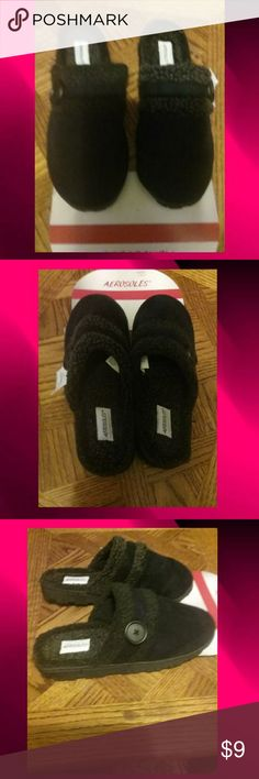 Ladies Shoe Slippers NWT.  Has one button on each slipper for design .  All man made material.  The tag says the product may contain faux fur.  It's very soft. Has a thin ridge to hold heels from slipping. Two tone black and light blackish color. Thick black soles. AEROSOLES Shoes Slippers
