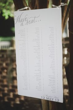 a simple seating chart tied up with ribbon Photography by Tim Will Photography / timwillphoto.com/, Event Design   Planning by W.E.D / charlestonevent.com