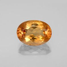 Golden Imperial Topaz gemstone from Brazil. carat Oval Facet 11 x 8 mm Natural, Fine Quality Loose Gem for jewelry available at GemSelect. Topazio Imperial, Topaz Gemstone, 2 Carat, Gems And Minerals, Jewels, Jewellery, Gemstones, Crystals, Yellow