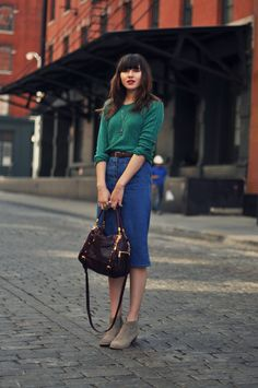 natalie off duty. green cashmere sweater, button down denim skirt and taupe booties.