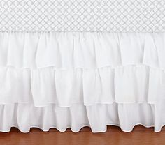Ruffle Crib Skirt - This one is pricey but I'm sure I can find something similar for cheaper.