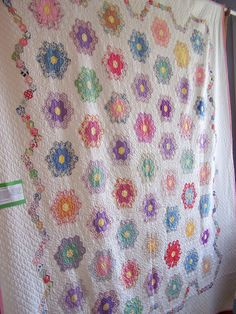 """Beautiful antique grandmother's flower garden quilt. Each flower has an outer ring of white so that when they're joined the """"pathway"""" is wider. Could set mine like this."""