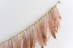 glitter dipped feather garland - chasing saturdays