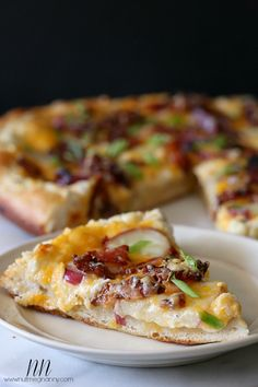 Loaded Baked Potato Pizza Recipe ~ Says:  My oh my! I never knew something so simple could be so grand. Creamy sour cream mixed with garlic and seasonings, sharp cheddar cheese, soft sliced potatoes and lots of crispy bacon.