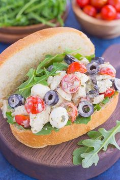 This Italian Chicken Salad is fresh, easy, and bursting with flavor.Loaded with mozzarella cheese, tomatoes, black olives and pesto, this fun twist ona classic flavor will have you coming back for more. This salad is perfect for an easy lunch or dinner and makes delicious sandwiches, too!