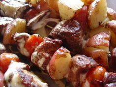 ranch style steak kabob:     4 new potatoes, cut in half **      1/4 cup KRAFT Ranch Dressing, divided      1 lb. boneless beef sirloin steak, cut lengthwise into 1/2-inch-thick slices      8 cherry tomatoes