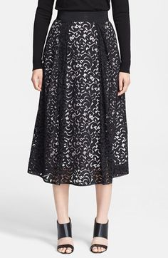 Free shipping and returns on Milly Lace Midi Skirt at Nordstrom.com. A full, feminine tea-length skirt is veiled with bold black lace.