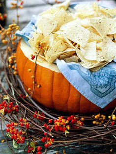 Hollow out a pumpkin for a cute harvest serving bowl. See the rest of this fall party: http://www.bhg.com/crafts/party-ideas/themes/throw-a-fall-harvest-party/?socsrc=bhgpin092212pumpkinchipbowl