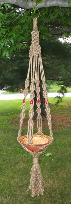 Crown Knot Macrame Plant Hanger Red Beads. $15.00, via Etsy.