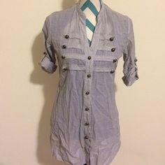 Military button blue pinstriped shirt Cute blue pinstriped shirt with military style buttons. Sleeves can be adjusted with buttons. Other then the wrinkles, there are no stains, rips or holes. In great condition. 100% cotton. Super comfy! Tops