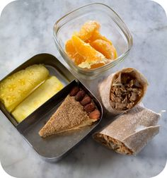 Easy lunch box ideas: barbecue pulled chicken and cheese on a whole-wheat tortilla; pineapple spears; mystery cake; and orange segments drizzled with olive oil and salt. http://www.LunchBoxBlues.com
