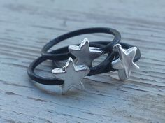 3 Silver leather rings - Black leather stacking rings with stars , minimalist jewelry , boho leather rings  Have a desire for stacking rings? These 3 fashionable black leather, gold and silver plated handmade rings are for you. Featuring soft round shape with high quality gold and silver plated stars. These classic rings are lovingly created with high quality components and finish, also for the boho chic fans with a special point of view.  Leather color: black Rings thickness: 0.06 inch…