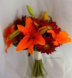 Hand-tied bouquet: Orange Lilies & Red Gerbera Daisies by Rose of Sharon-Event Florist, via Flickr.  add calla lilies.