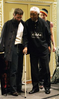 Nelson Mandela and Yusuf Islam during '46664 The Concert' Book Launch Photocall at The Dorchester Hotel in London Great Britain