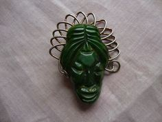 Hey, I found this really awesome Etsy listing at https://www.etsy.com/listing/234138873/bakelite-african-mask-pin