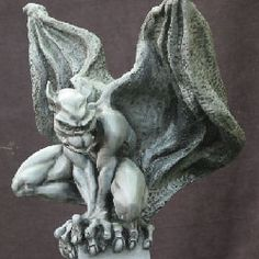 This gargoyle is Draga, created by a fantastic sculptor named Sandra Lira.  He is part of my collection.