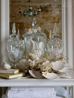 Glass jars filled with shells