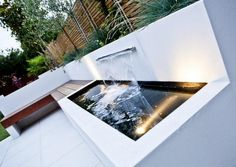 Striking modern garden design divided into three sections for a long thin family garden in Strawberry Hill, Twickenham, West London. Modern Pond, Modern Garden Design, Modern Patio, Modern Design, Contemporary Design, Contemporary Water Feature, Contemporary Garden, Contemporary Outdoor Fountains, Small Water Features