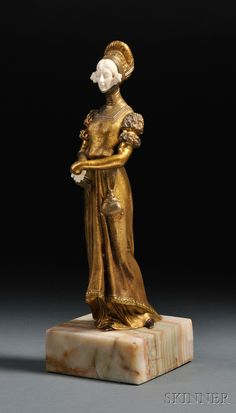 """Dominique Alonzo (French, fl. 1910-1930)   Art Nouveau Sculpture of an Elizabethan Figure  Signed """"Alonzo"""" on the figure's train, stamped """"MADE IN FRANCE HM"""" l.l.  Gilt-bronze and ivory sculpture, mounted to an onyx plinth."""