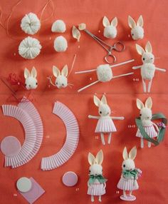 rabbits out of pom poms and cupcake paper