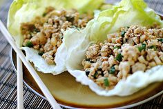 Asian Lettuce wraps:  1 1/4 lb. fat-free ground turkey  1 Tbsp vegetable oil  1 clove garlic, minced  1/8 tsp. ground ginger  2/3 cup thinly sliced green onions (about 4)  1 (8 oz) can sliced water chestnuts, drained and coarsely chopped  12 Boston lettuce leaves  3 Tbsp hoisin sauce  2 Tbsp lower-sodium soy sauce (green top)  1 Tbsp rice vinegar  2 tsp. roasted red chili paste  1/8 tsp. salt