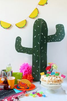 Cardboard cactus props, taco banner, papel picado cake decorations - great party