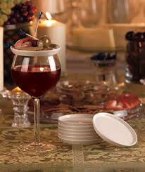 So you can buy the plates... Or... Why not buy plastic plate and mount cork or wood pegs on the bottom of the plate... Using your wine glass dimension.