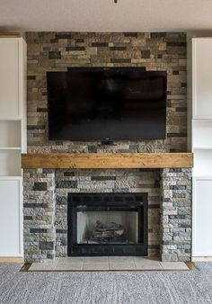 I like how wide the made the fireplace surround. It balances the tv. Do not like stone above fireplace   Airstone fireplace surround fireplace makeover ideas living room decorating ideas