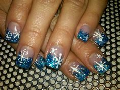 Nails....*let it snow* Create these using your favorite blue acrylic. Just blend it up...no smile line here. Cap with pink. After nails are finished, use your striping brush to create snowflakes. Next add dots to each.