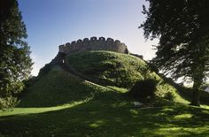 Totnes Castle    Devon   South West.    A classic Norman motte and bailey castle, founded soon after theConquest to overawe the Saxon town. A later stone shell-keep crowns its steep mound, giving views across the town to the River Dart.  via English Heritage